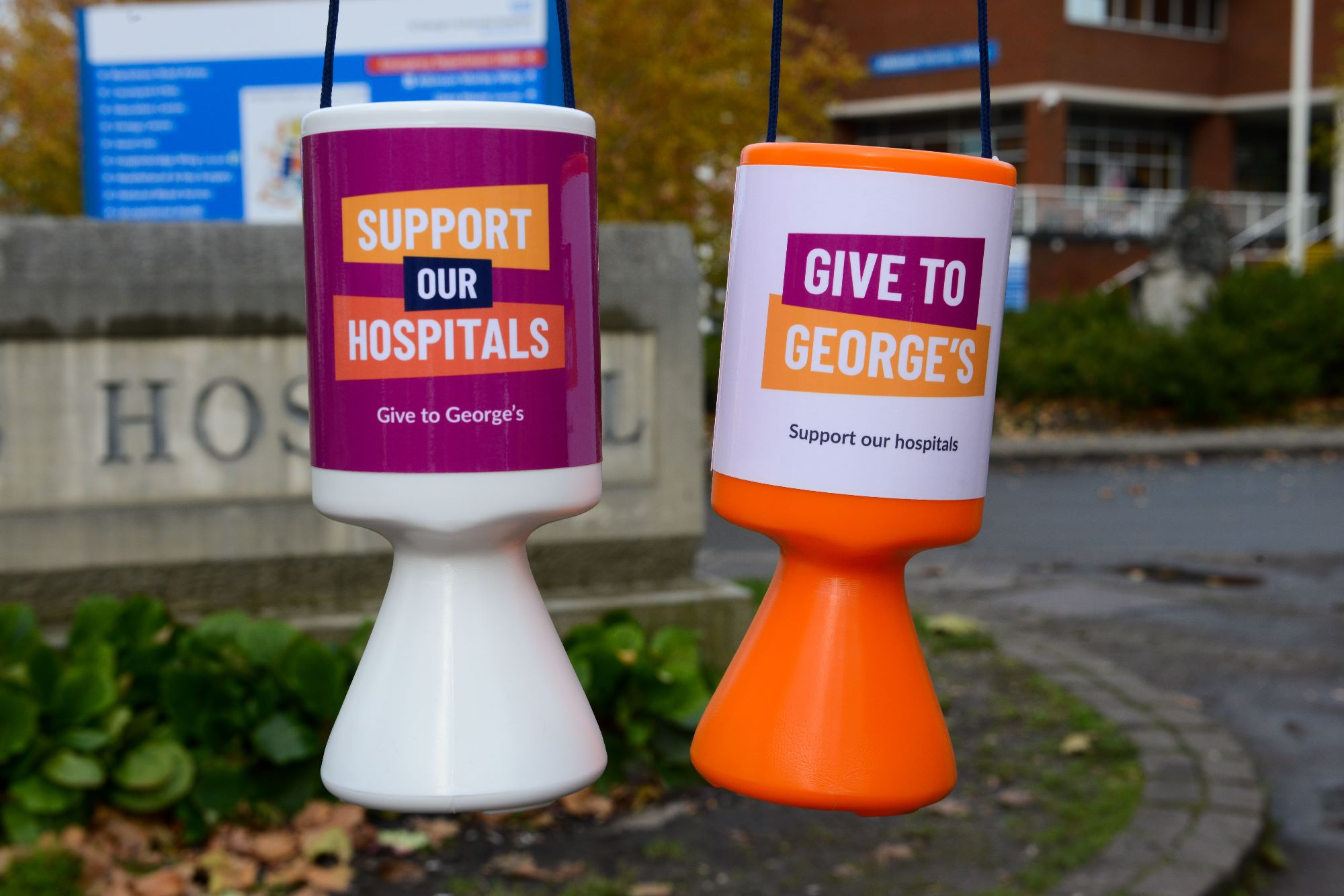Our branded collection tins in front of the St George's Hospital sign.jpg