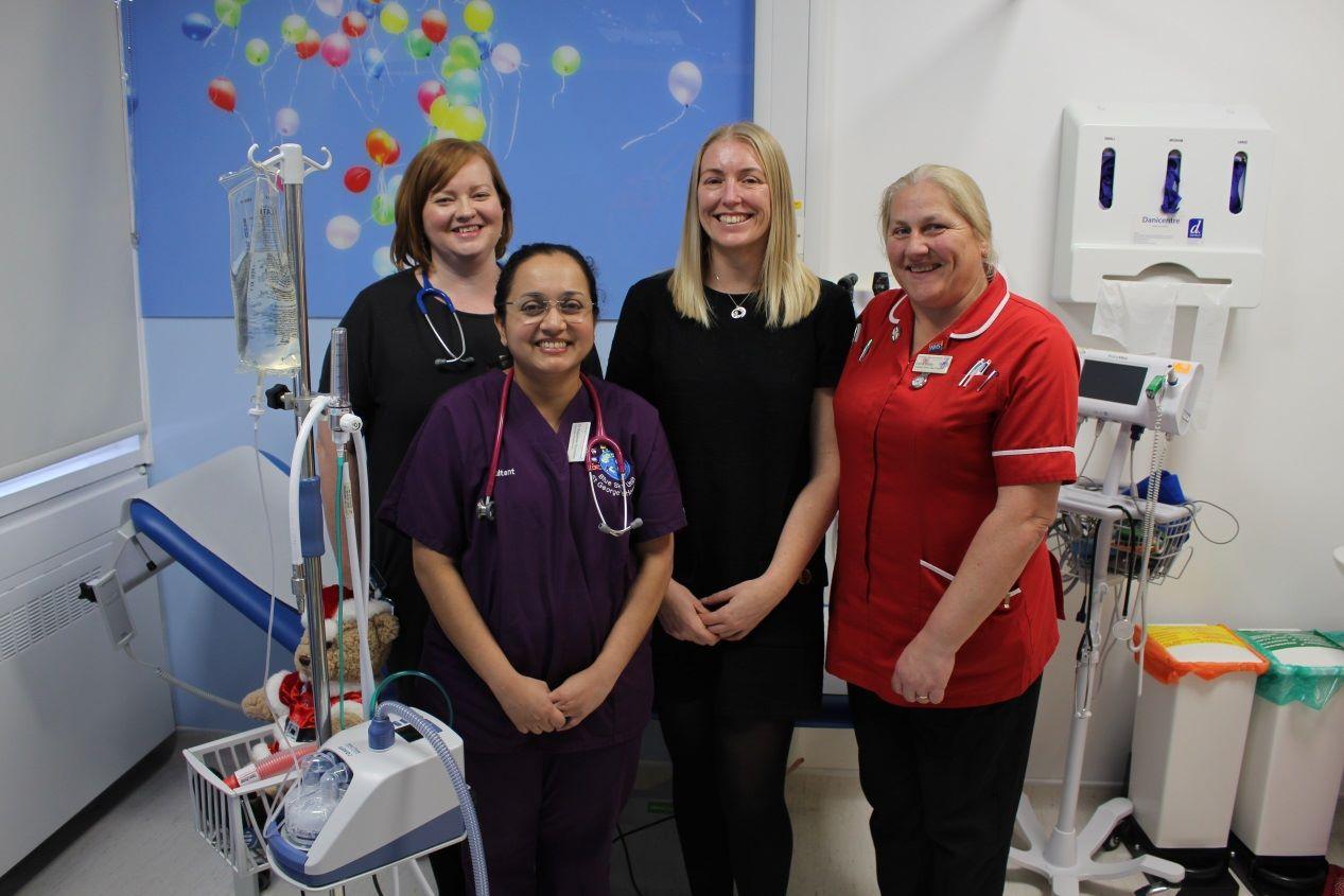 Medical staff pose with new Optiflow respiratory system for paediatrics.jpg